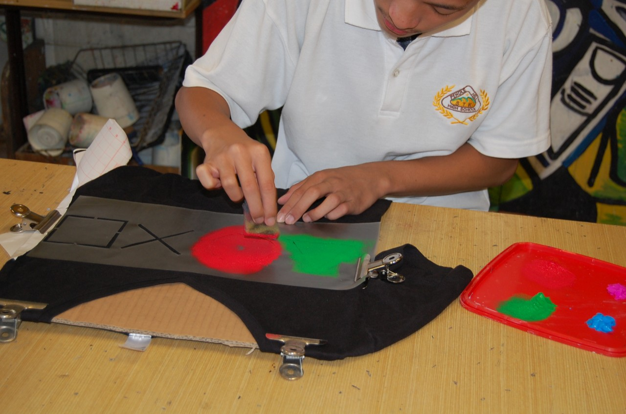 Students create their own art work on T-shirts