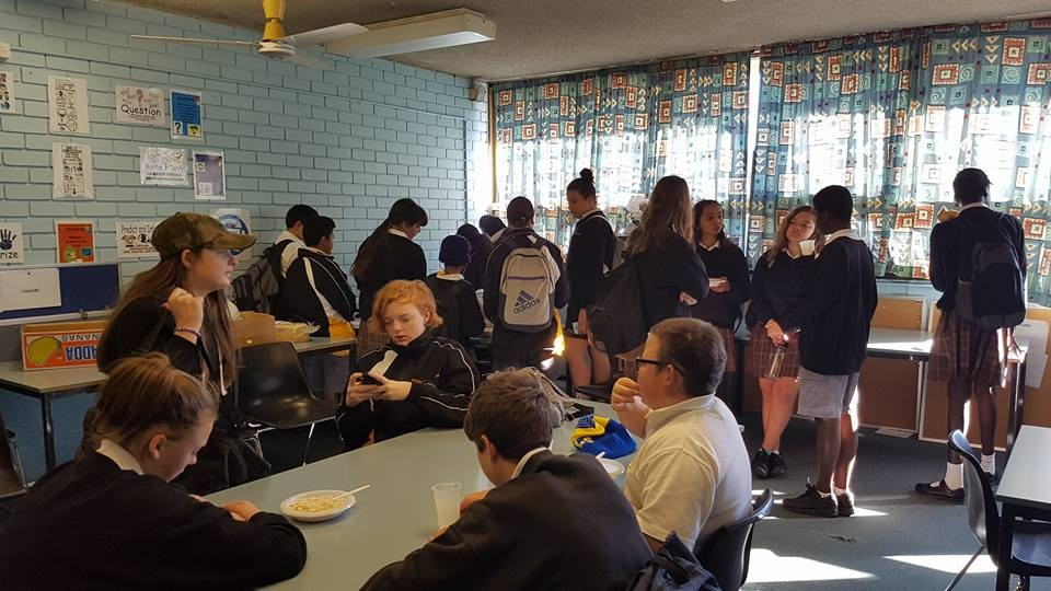 Full house of students at breakfast club.