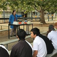 Staff performs a chemistry demonstration for students.